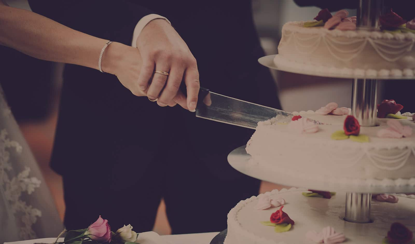 married people cut the wedding cake